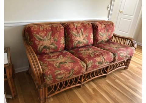 Wicker loveseat and end table